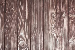 The wooden wall to illustrate staining a fence