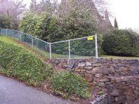 chain link fence down hill