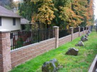custom iron and brick fence