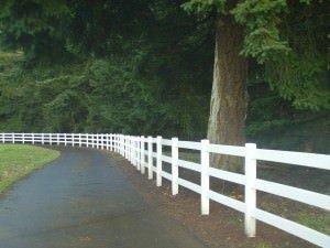 Vinyl fences on a driveway