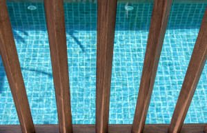Wooden fence with swimming pool background