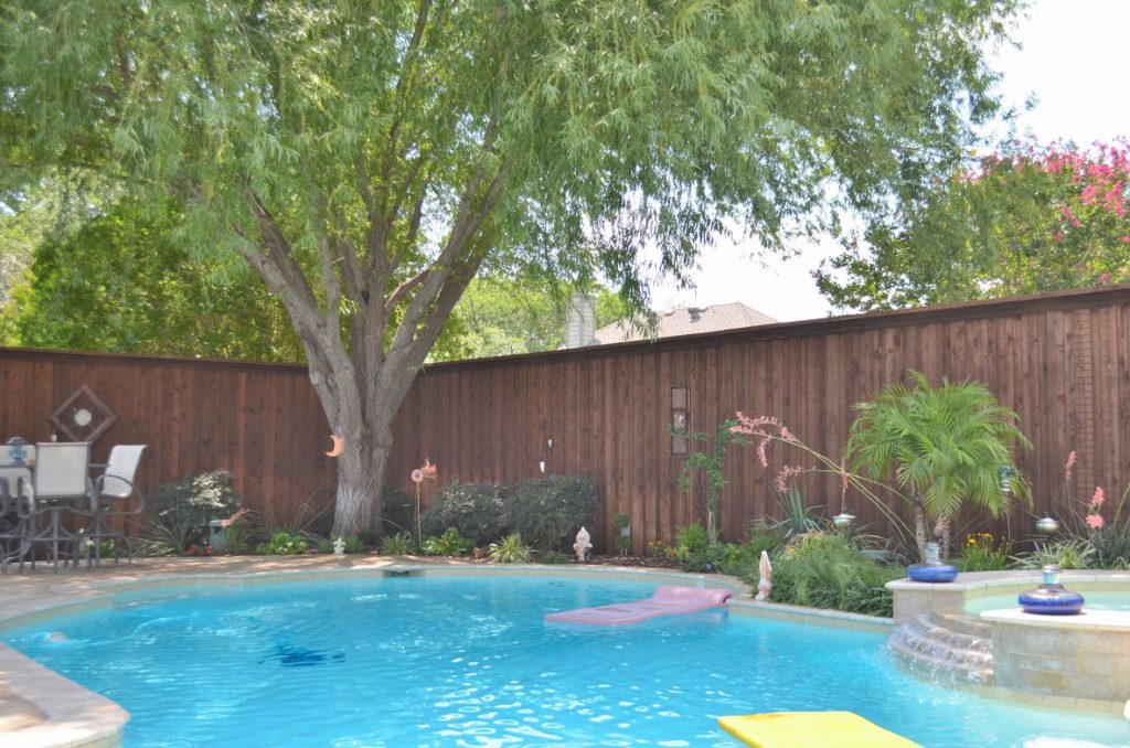 Beautiful brown fence around a well-kept pool