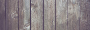 Wooden board background to illustrate How to Replace a Wooden Fence Panel