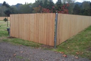 How to install fence posts that are steel for a wood fence