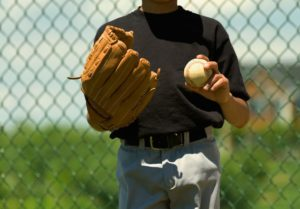 Designing an Athletic Field Fence. A baseball player is seen.