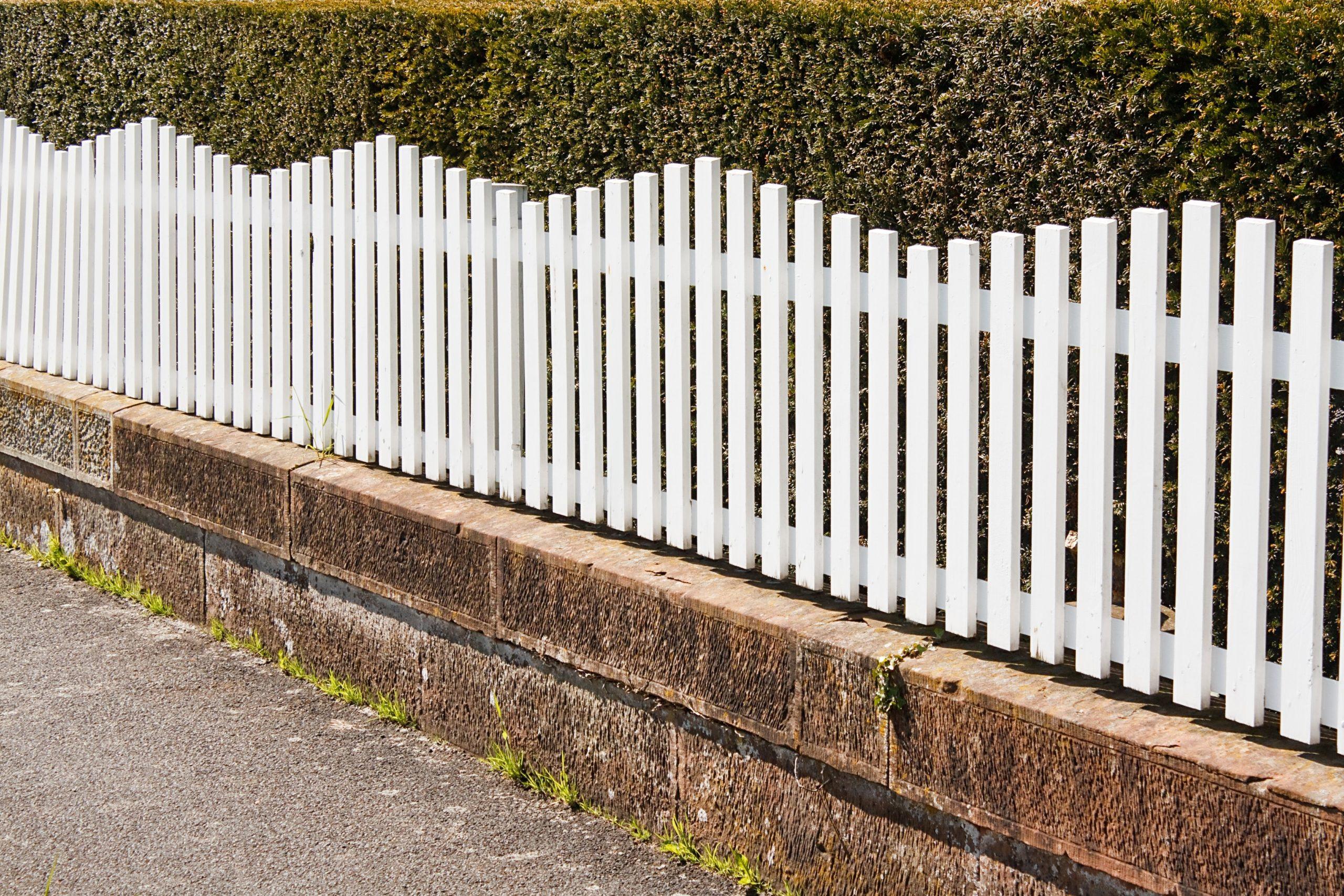 white picket fence on sidewalk