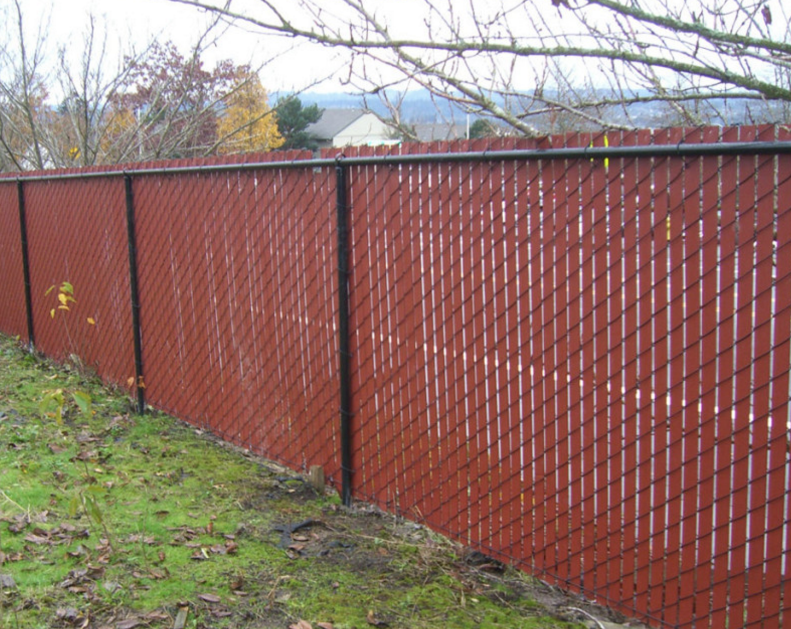 Add color to a chain link fence with red privacy slats.