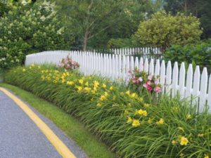 A white picket fence is a classic look.