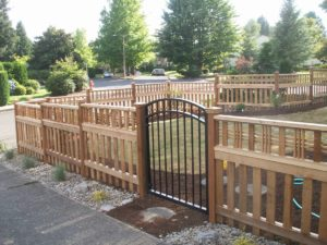 Custom Fence and Gate with different types of fence posts