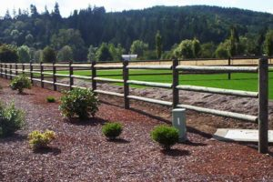 custom wood fence with different types of fence posts