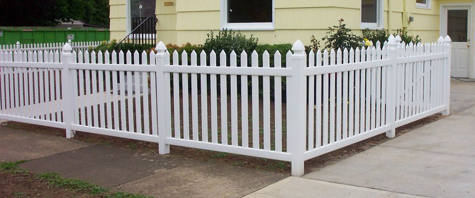 vinyl picket fence in front of a home.
