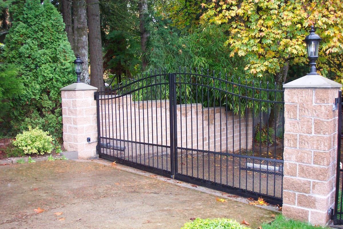 Black, wrought iron driveway gate