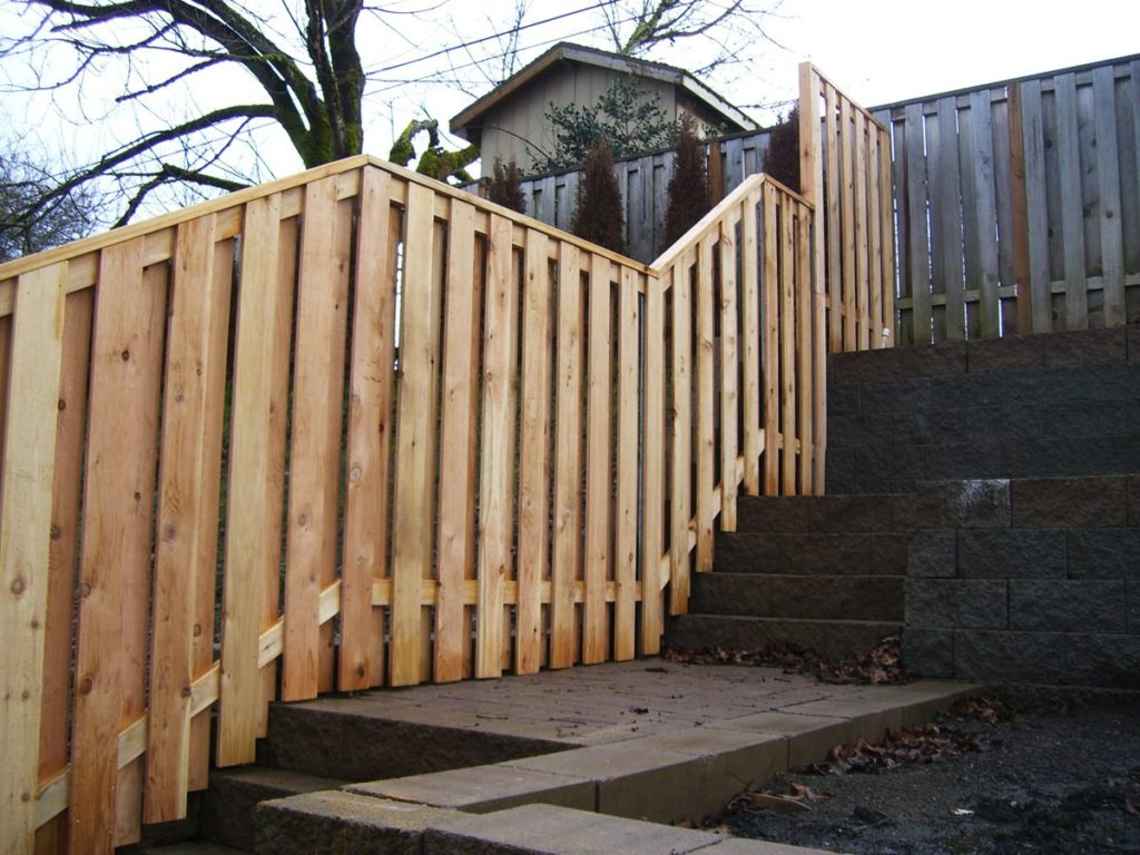 Wooden fence built on a slope